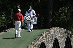 Phil Mickelson and Lee Westwood walk over the Hogan Bridge on Sunday.