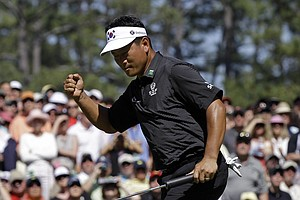 K.J. Choi pumps his fist after sinking a birdie putt on the sixth hole Sunday.