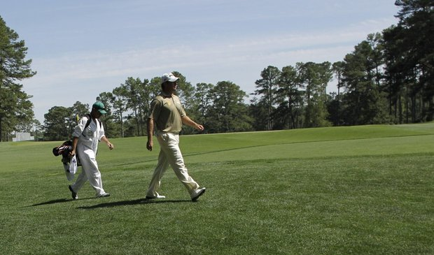 Lee Westwood walks down the fourth fairway with his caddie Billy Foster during the third round of the Masters.