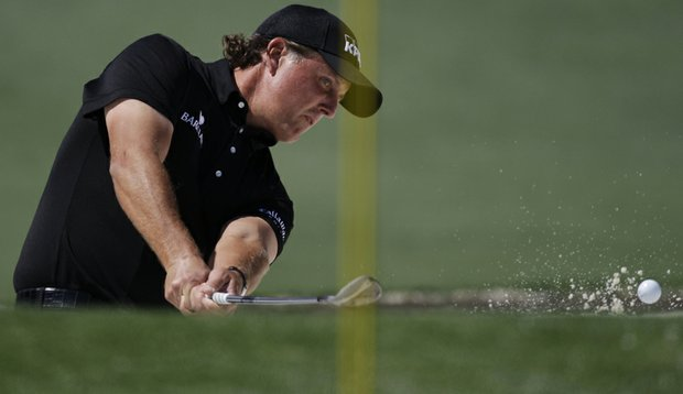 Phil Mickelson blasts out of a bunker on the second hole Sunday at Augusta.