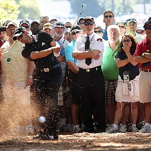 Sergio Garcia hits a shot from the pine needles during the final round of the Masters.