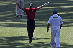 Tiger Woods reacts after holing out from eagle on the par-4 seventh hole Sunday.