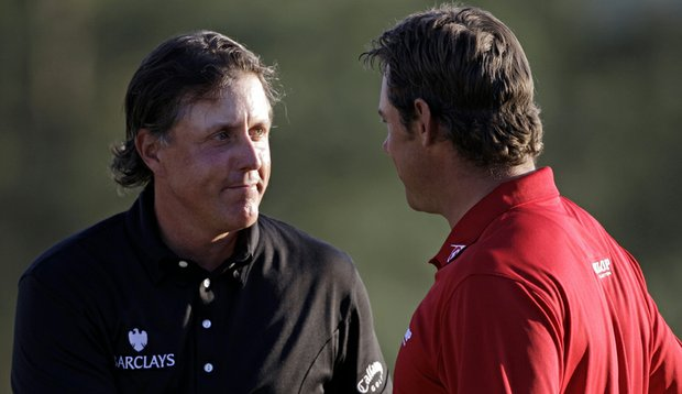 Lee Westwood (right) shakes hands with Masters champion Phil Mickelson on Sunday.