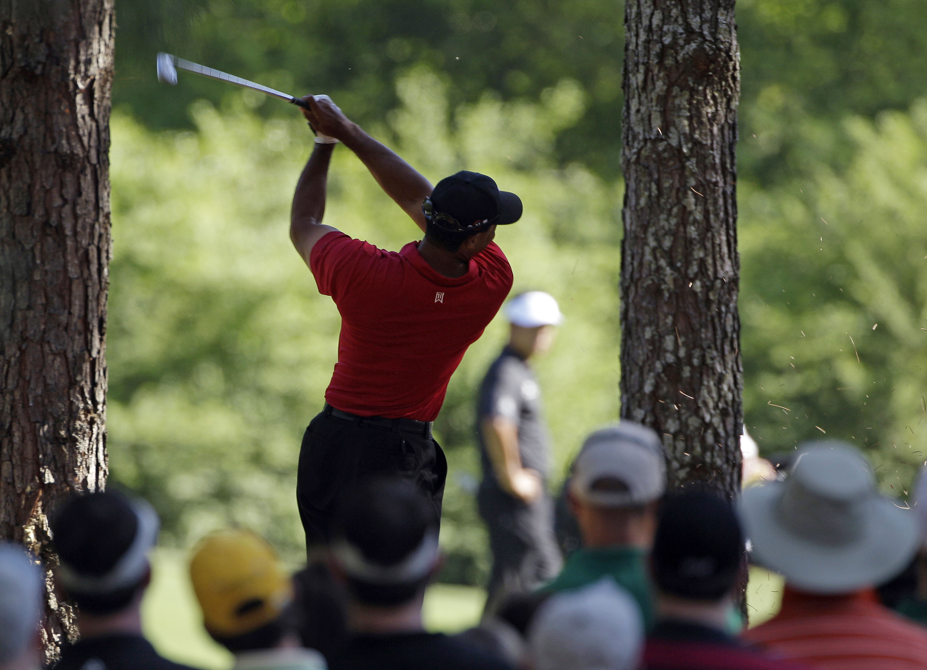 Tiger Woods plays his second shot on No. 11 during the final round of the Masters.