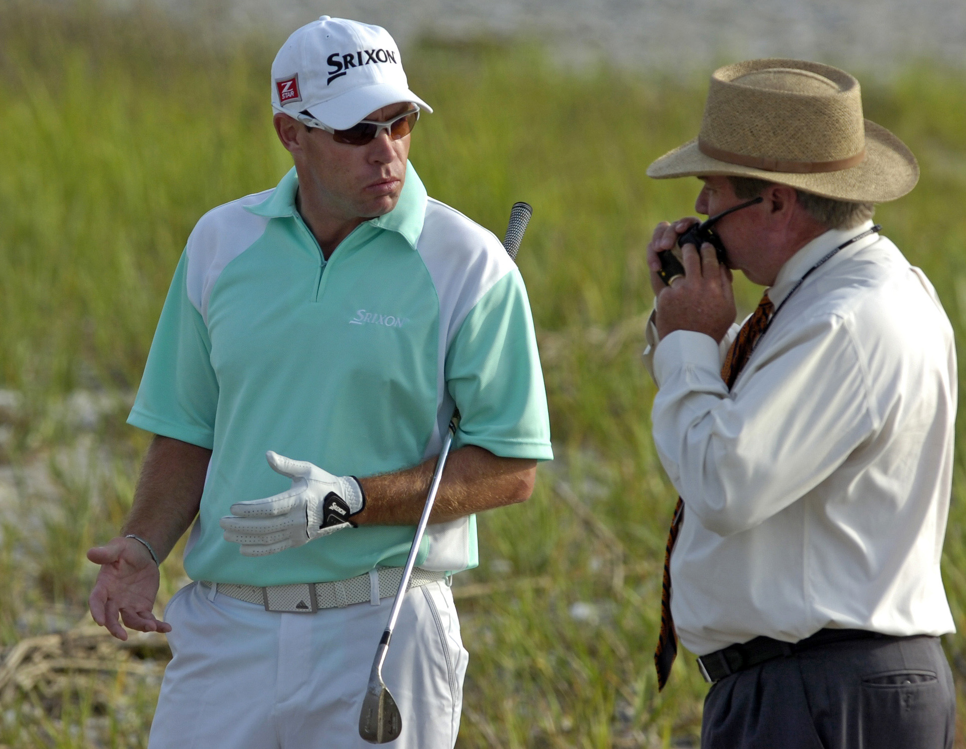 Brian Davis, left, talks with Slugger White during a playoff April 18 at the Verizon Heritage. Davis called a two-stroke penalty on himself and lost to Jim Furyk.