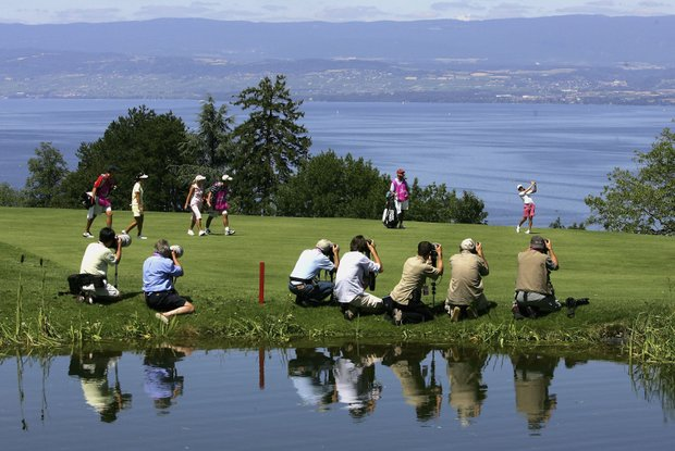 Lorena Ochoa of Mexico has the attention of photographers as she hits her second shot on the fourth hole during the first round of the Evian Masters on June  20, 2005 in Evian, France.