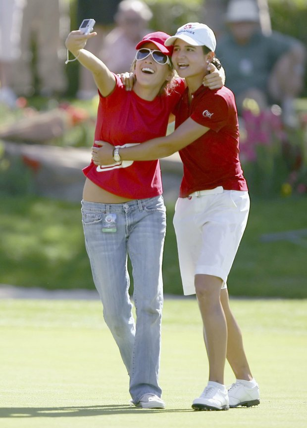 Lorena Ochoa of Mexico takes a picture with a fan after winning the 2006 LPGA Takefuji Classic on April 15, 2006 at the Las Vegas Country Club in Las Vegas, Nevada.
