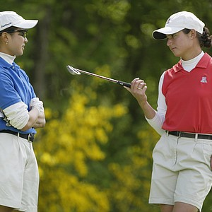 Virada Nirapathpongporn (l) of Duke   chats with Lorena Ochoa of Arizona during the third round of the 2002 Women's NCAA Golf Championships at Washington National Golf Club on May 23, 2002.