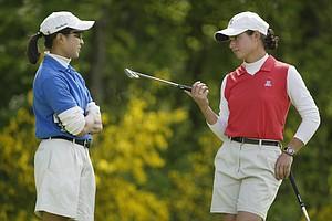 Virada Nirapathpongporn (l) of Duke   chats with Lorena Ochoa of Arizona during the third round of the 2002 Women's NCAA Golf Championships at Washington National Golf Club on May 23, 2002.