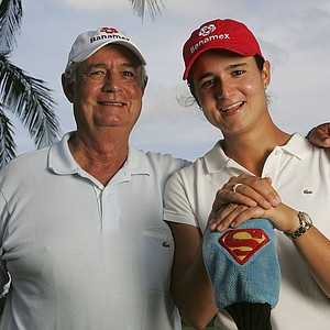 LPGA Player of the Year Lorena Ochoa of Mexico poses with her father Javier for a portrait prior to the start of the ADT Championship at Trump International Golf Club on November 15, 2006.
