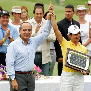Mexico President Felipe Calderon presents Lorena Ochoa of Mexico a plaque during the trophy ceremony after the final round of the Corona Championship April 29, 2007 at Tres Marias Club de Golf in Morelia, Michoacan, Mexico.  (