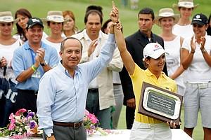 Mexico President Felipe Calderon presents Lorena Ochoa of Mexico a plaque during the trophy ceremony after the final round of the Corona Championship April 29, 2007 at Tres Marias Club de Golf in Morelia, Michoacan, Mexico.  (