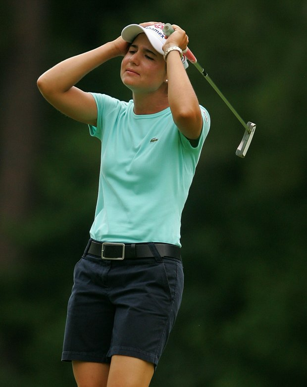 Lorena Ochoa of Mexico reacts to a near eagle putt on the first green during round three of the U.S. Women's Open Championship at Pine Needles Lodge & Golf Club on June 30, 2007.