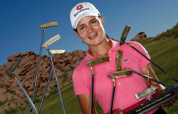 LPGA player Lorena Ochoa of Mexico poses with nine gold Ping putters prior to the start of the J Golf Phoenix LPGA International at the Papago Golf Course March 24, 2009 in Phoenix, Arizona.