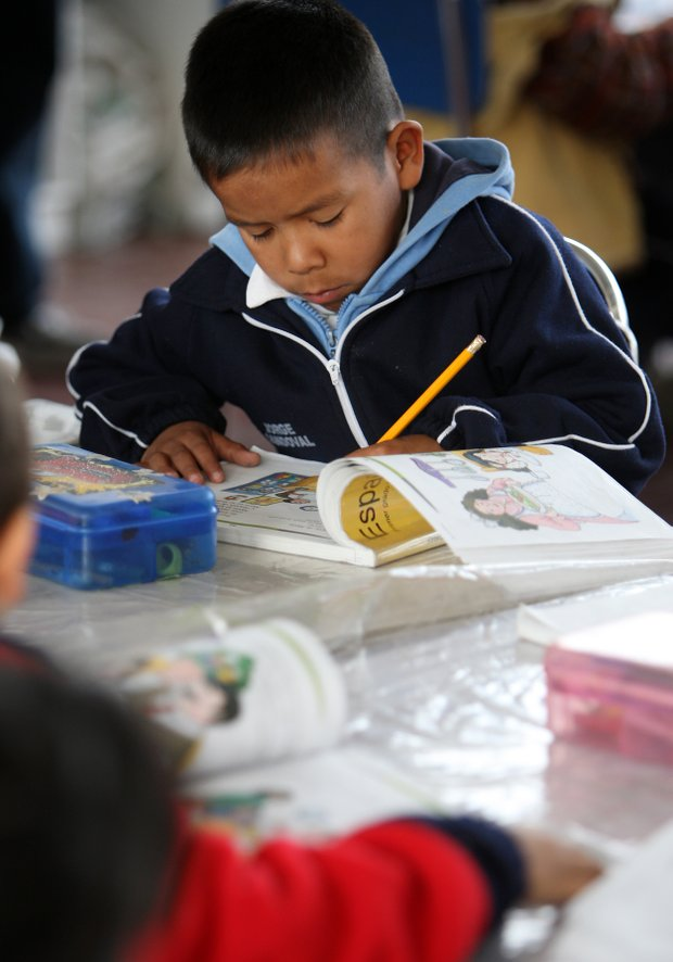 A young boy studies at the education center in La Barranca, which is funded by Ochoa.