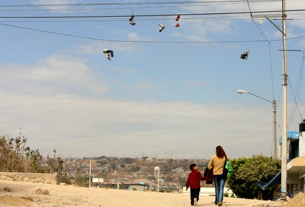 A young boy and his mother walk home from a day of school at the education center of La Barranca.