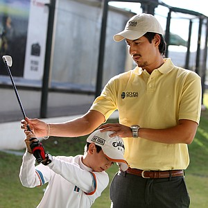 Alejandro Delgado works with student Alan Alonso Ascencio, 10, at Lorena Ochoa's Golf Academy.