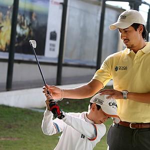 Alejandro Delgado works with student Alan Alonso Ascencio, 10, at Lorena Ochoa's Golf Academy.