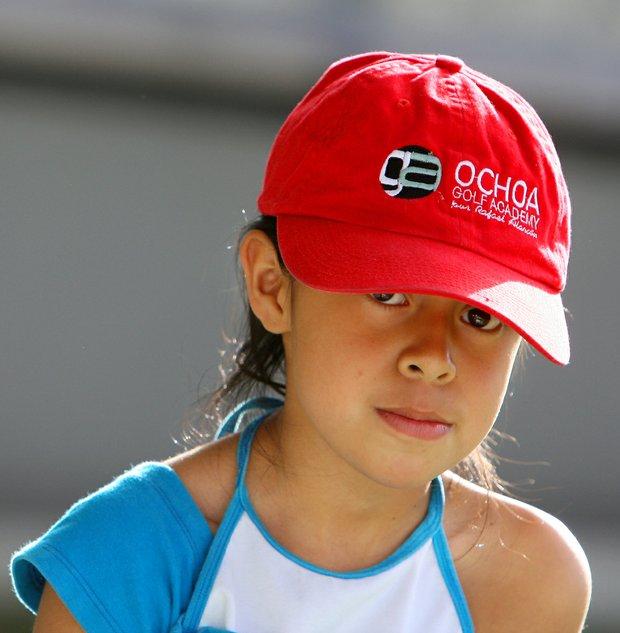 Nayelli Jazmin Gonzalez Gutierrez, 8, sports a Ochoa Golf Academy hat while practicing at the La Barranca School.