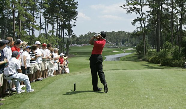 Tiger Woods tees off on the fourth hole during the final round of the 2009 Players Championship.