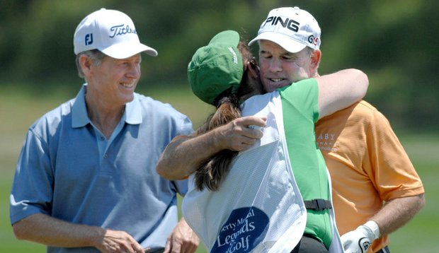 Ken Green hugs his sister, Shelley White, who caddied for him Friday during the Champions Tour's Liberty Mutual Legends of Golf.