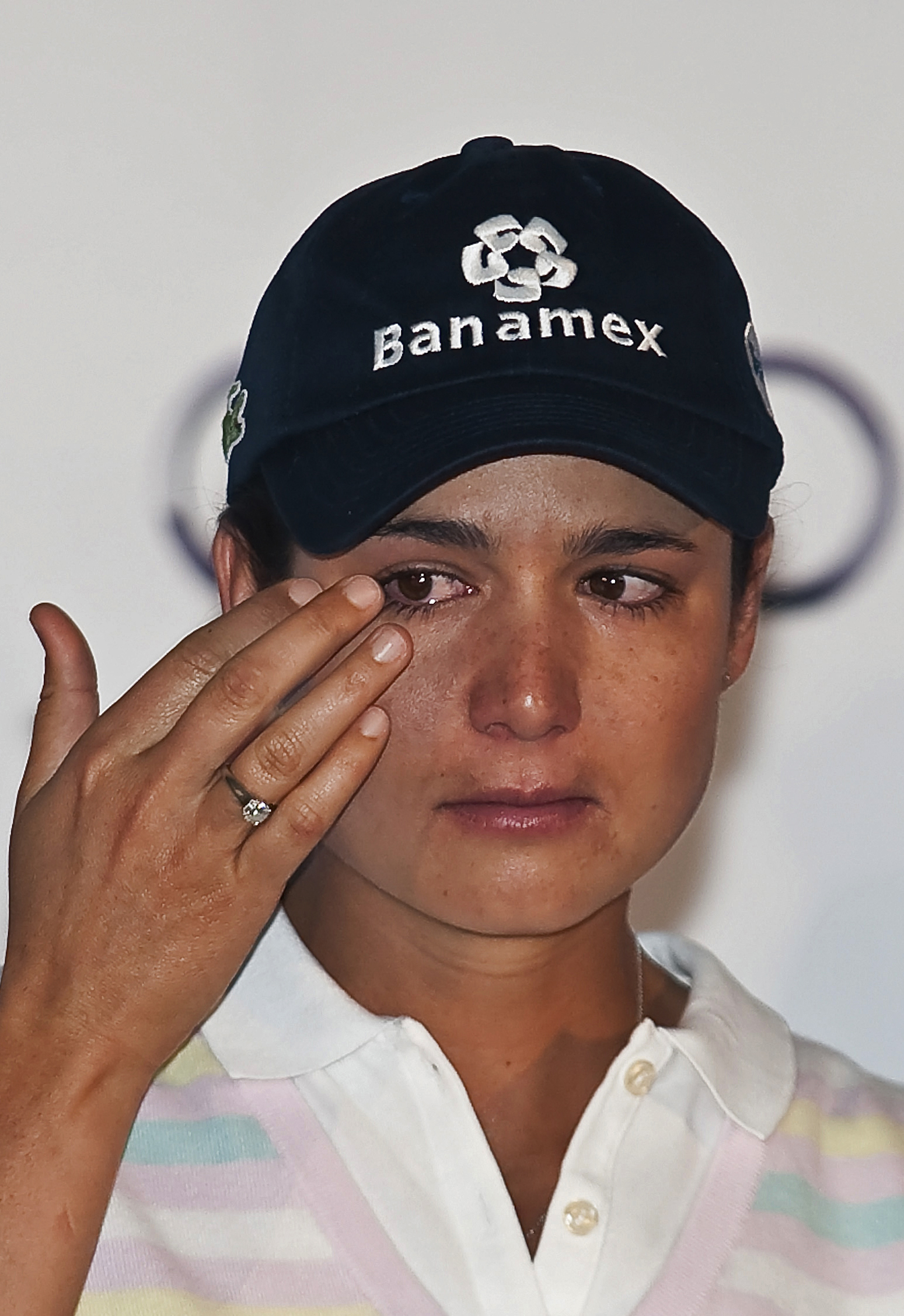 Lorena Ochoa wipes away a tear as she announces her retirement from the LPGA.