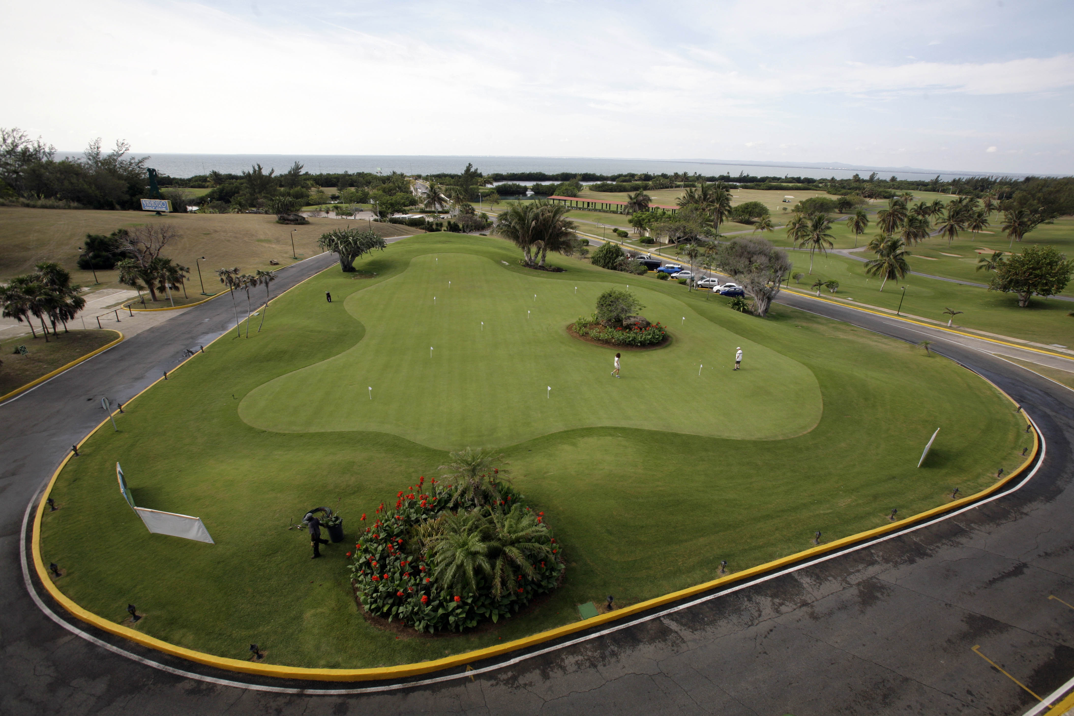 Golfers take to the practice area during the Montecristo Cup Golf Tournament in Varadero, Cuba.