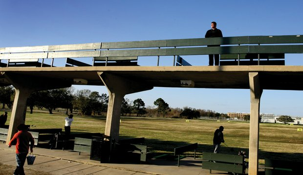 Don Tillar Jr., general manager of City Park's North Course, stands just above Katrina's high-water mark atop the park's double-decker range.