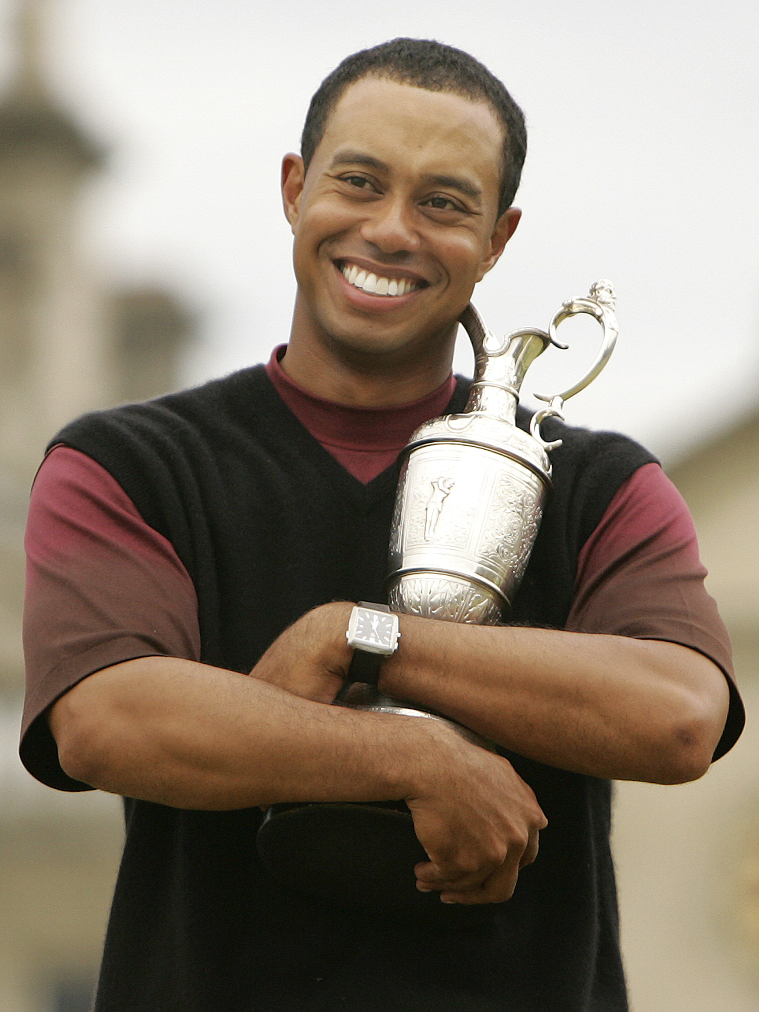 Tiger Woods cradles the Claret Jug after winning the 2000 British Open at St. Andrews.