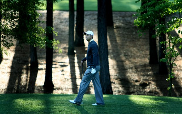 Tiger Woods is captured in a solitary moment during Wednesday's pro-am at the Quail Hollow Championship in Charlotte. (April, 2010)