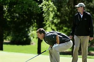 Former NFL quarterback Dan Marino lines up a putt.