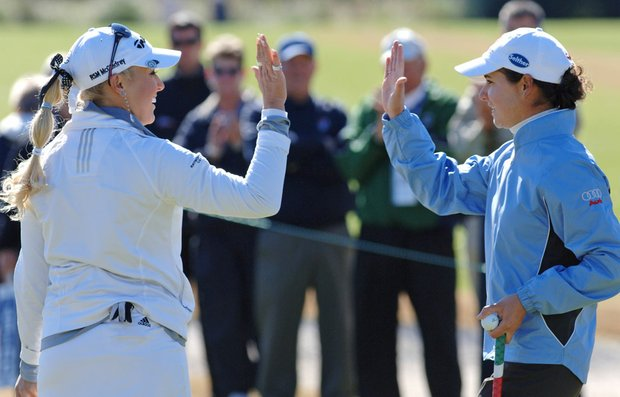 Natalie Gulbis, left, and Lorena Ochoa exchange high-fives after sinking a putt on the fifth hole of the Annika Celebration golf skins game in February.