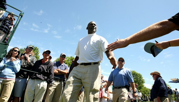 Michael Jordan walks to the first tee during Wednesday's pro-am at the Quail Hollow Championship.