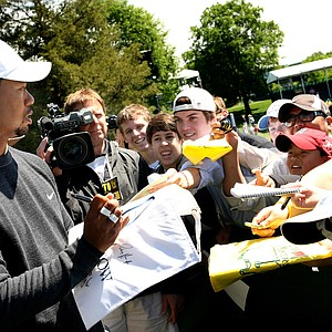 Tiger Woods signs autographs April 28 at the Quail Hollow Championship.