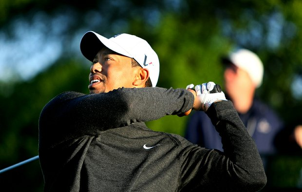 Tiger Woods tees off at No. 1 during the Quail Hollow Championship pro-am.
