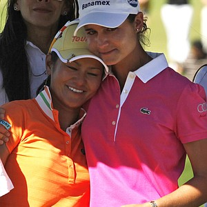 Ai Miyazato and Lorena Ochoa embrace after the Tres Marias Championship.