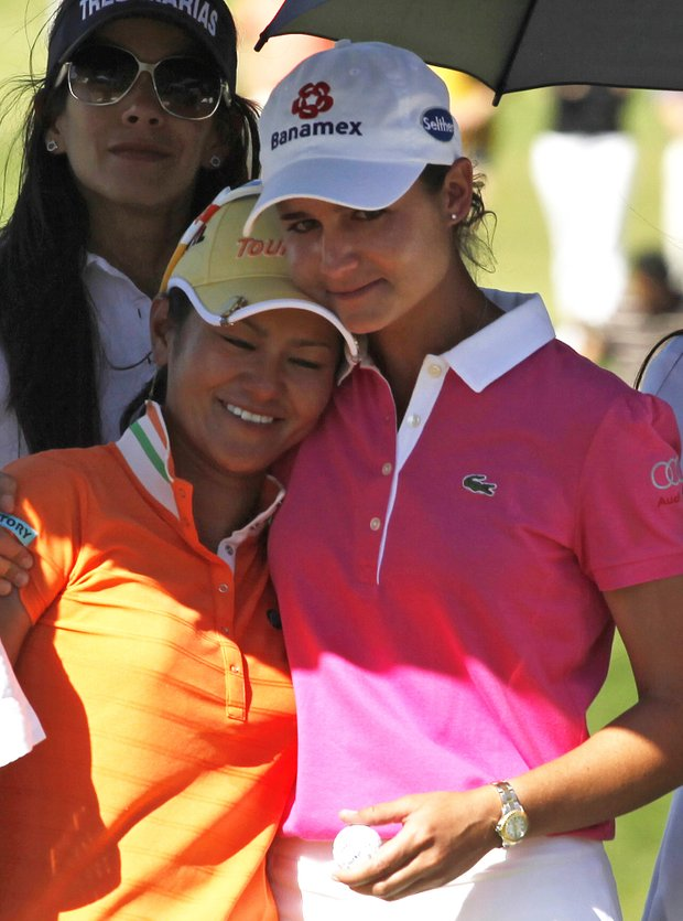 Ai Miyazato and Lorena Ochoa embrace after the Tres Marias Championship.