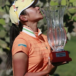 Ai Miyazato kisses a trophy after wining the Tres Marias Championship.