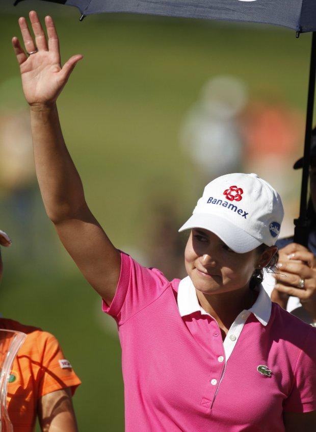 Lorena Ochoa waves to the crowd following the Tres Marias Championship.