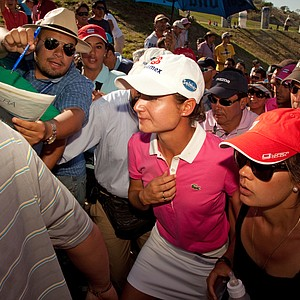 Lorena Ochoa is mobbed by fans at the Tres Marias Championship.