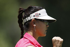 Michelle Wie pumps her fist after making a putt on the fifth hole during the final round of the Tres Marias Championship.