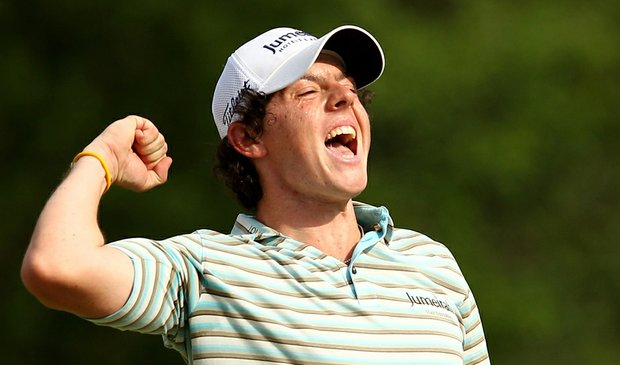 Rory McIlroy celebrates as he holes a birdie putt on the 18th green to win the Quail Hollow Championship.