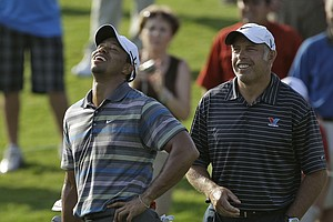 Tiger Woods and caddie Steve Williams share a laugh Wednesday at The Players.