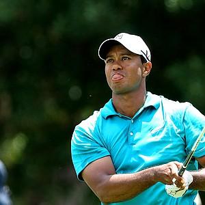 Tiger Woods watches his tee shot at No. 9.