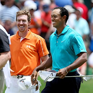 Tiger Woods, right, and Hunter Mahan, left, played Friday's round together.