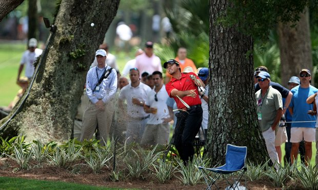 Jason Day hits out of a clump of trees at No. 9. Day missed the cut shooting 74,72.