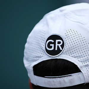 Jorge Gamarra, who caddies for Francesco Molinari, sports a hat with the initials GR to honor longtime caddie Greg Rita. Many caddies wore the initials in remembrance of Rita, who died Feb. 27 of brain cancer.