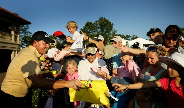 Phil Mickelson signs autographs after Friday's round.