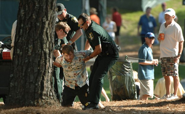 St. Johns County deputy sheriffs cuff Travis Parmelee, who was Tasered Friday at The Players Championship.