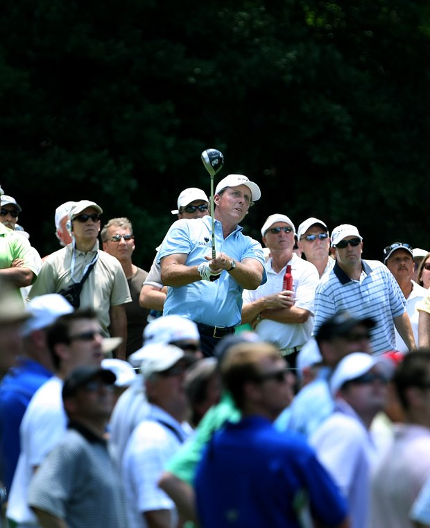 Phil Mickelson hits his tee shot at No. 15. Mickelson is T11 after Saturday.